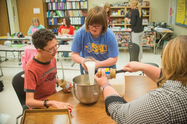 students-robert-lewis-from-left-olivia-dixon-and-shelley-moore-mix-a-batch-of-k9-crackers-in-their-community-based-instruction-class-at-cabot-high-school-dixon-said-her-favorite-part-of-making-the-dog-treats-is-mixing-the-ingredients-while-lewis-said-he-enjoys-bagging-the-crackers-and-feeding-them-to-his-furry-friends
