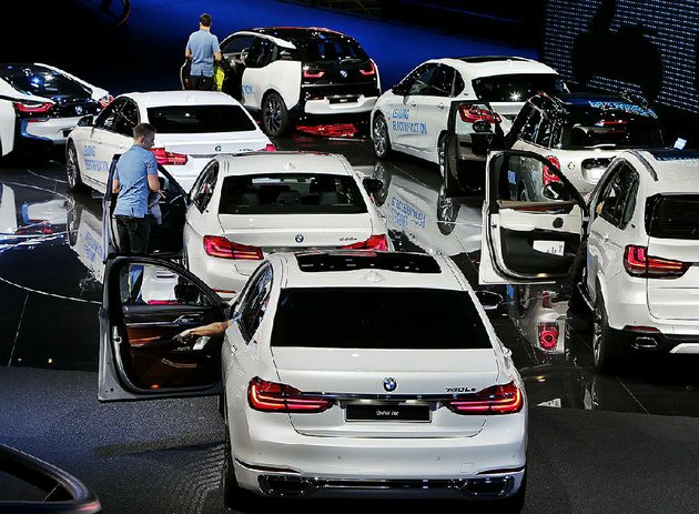 drivers-settle-into-bmw-vehicles-on-display-wednesday-at-an-auto-show-in-frankfurt-germany