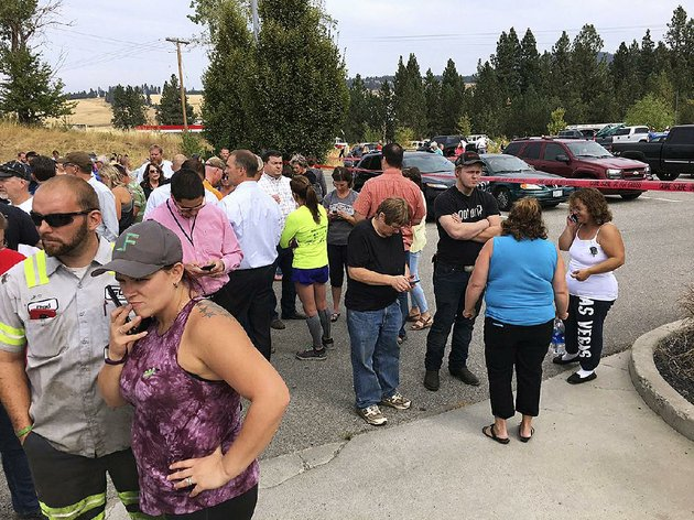 parents-gather-in-the-parking-lot-behind-freeman-high-school-in-rockford-wash-to-wait-for-stu-dents-after-a-deadly-shooting-at-the-high-school-wednesday