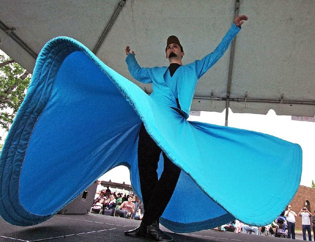 whirling-dervish-onur-kasaburi-performs-at-last-years-turkish-food-festival-this-years-festival-of-food-arts-and-crafts-and-performances-is-planned-for-saturday-at-the-raindrop-turkish-house