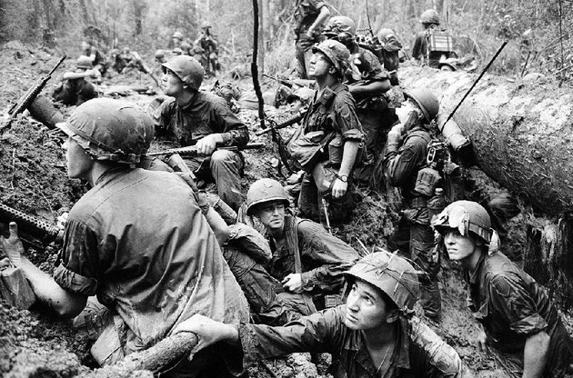 american-troops-keep-a-wary-eye-out-for-viet-cong-snipers-in-this-1967-file-photo-ken-burns-the-vietnam-war-debuts-sunday-on-aetn