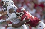 Arkansas linebacker Dre Greenlaw makes a tackle during a game against TCU on Saturday, Sept. 9, 2017, in Fayetteville.