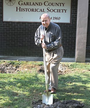 The Sentinel-Record/Richard Rasmussen HISTORICAL DIG: Garland County Historical Society volunteer Orval Allbritton digs the ceremonial first shovel load of dirt Friday during the official groundbreaking for the society's expansion of its archives building at 328 Quapaw Ave.
