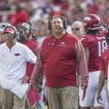 Arkansas offensive coordinator Dan Enos (left) and coach Bret Bielema on the sideline as the Razorba...