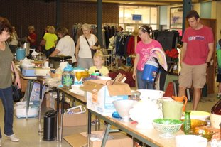 Sale: Shoppers rummage through items during a sale benefitting the Union County Animal Protection Society (UCAPS).