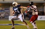 Pulaski Academy receiver Hudson Henry (left) fights off a hit by Bossier City Parkway defensive back Arthur Joseph during Friday night's game at Joe B. Hatcher stadium in Little Rock.  Special to the Democrat-Gazette/JIMMY JONES