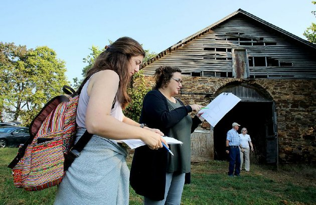 lauren-lambert-and-katie-murphy-graduate-students-at-the-university-of-louisiana-at-lafayette-review-architectural-documents-friday-in-front-of-the-horse-barn-at-fitzgerald-station-in-springdale-students-from-the-university-will-come-up-with-plans-for-the-site-which-once-was-a-stagecoach-stop-on-the-butterfield-overland-express-mail-route-dav-got