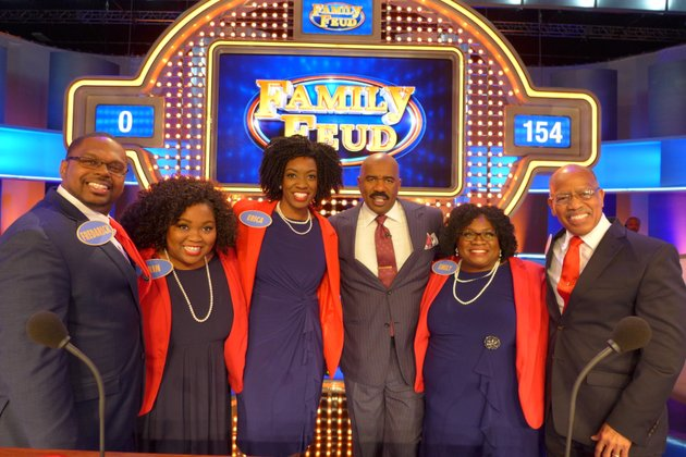 host-of-family-feud-steve-harvey-center-poses-with-the-chambers-family-from-left-fredarick-and-erin-wilson-and-erica-emily-and-earl-chambers