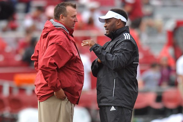 Arkansas coach Brett Bielema talks with Texas A&M coach Kevin Sumlin before the start of the teams' 2013 matchup at Razorback Stadium in Fayetteville.