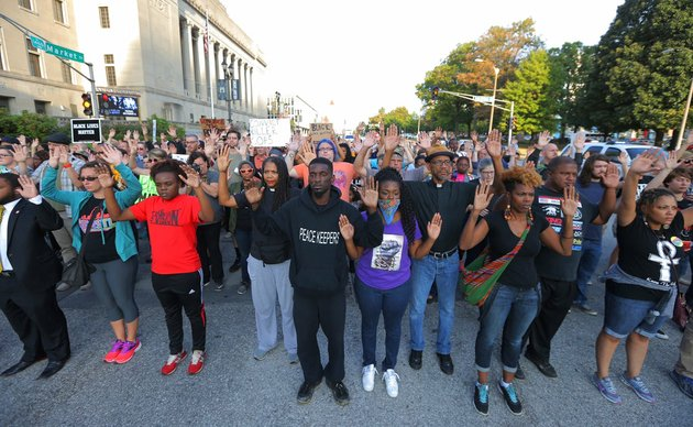 protesters-march-in-silence-down-market-street-in-st-louis-on-monday-sept-18-2017-in-response-to-a-not-guilty-verdict-in-the-trial-of-former-st-louis-police-officer-jason-stockley