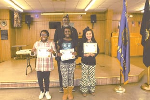 War on drugs: Three sixth grade students from Washington Middle School (from left) Diana Obiozo, Anastasia Montgomery and Maria Ruiz, pose with American Legion Adjutant Deacon Jones on Tuesday, Sept. 12 with their awards. The students decorated posters for a War on Drugs awareness contest and Obiozo, Montgomery and Ruiz's posters were chosen by the American Legion Post 10 members as first, second and third place for best poster.