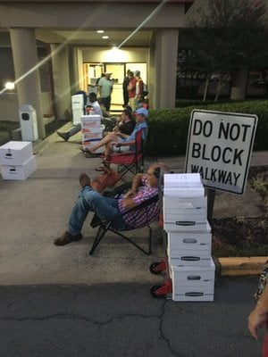 Applicants for medical marijuana cultivation and dispensary licenses wait for state offices to open Monday, Sept. 18, 2017.