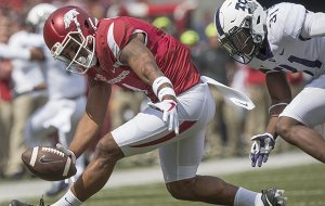 Arkansas receiver Jared Cornelius drops a pass in front of TCU's Ridwan Issahaku during a game Saturday, Sept. 9, 2017, in Fayetteville.