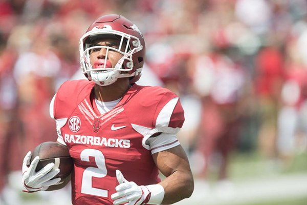 Arkansas running back Chase Hayden goes through warmups prior to a game against TCU on Saturday, Sept. 9, 2017, in Fayetteville.
