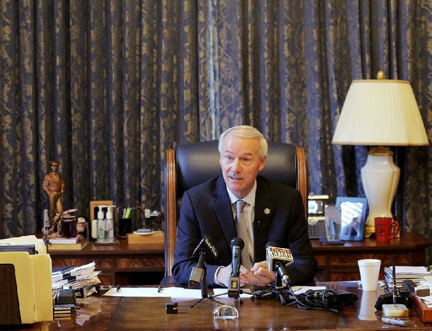gov-asa-hutchinson-talks-with-reporters-during-a-news-conference-in-his-office-tuesday-afternoon-at-the-state-capitol-in-little-rock