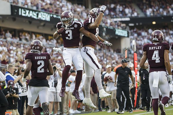 Texas A&M wide receiver Christian Kirk (3) celebrates a touchdown with teammate Kalvin Cline (89) during the first quarter of an NCAA college football game against Nicholls State Saturday, Sept. 9, 2017, in College Station, Texas. (AP Photo/Sam Craft)
