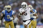 Texas A&M running back Trayveon Williams runs for a 61-yard touchdown against UCLA during the first half of an NCAA college football game, Sunday, Sept. 3, 2017, in Pasadena, Calif. (AP Photo/Danny Moloshok)