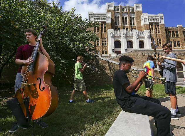 central-high-jazz-band-members-peter-mouw-left-and-kaylen-wilkerson-on-trumpet-join-fellow-members-in-front-of-the-school-thursday-to-practice-for-60th-anniversary-events-this-weekend