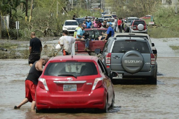 vehicles-travel-a-flooded-road-friday-after-hurricane-maria-passed-through-toa-baja-puerto-rico-where-thousands-of-people-were-evacuated-when-the-gates-of-the-rio-la-plata-dam-were-opened