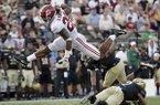 Alabama running back Najee Harris (22) leaps over Vanderbilt safety Arnold Tarpley III (2) in the second half of an NCAA college football game Saturday, Sept. 23, 2017, in Nashville, Tenn. (AP Photo/Mark Humphrey)