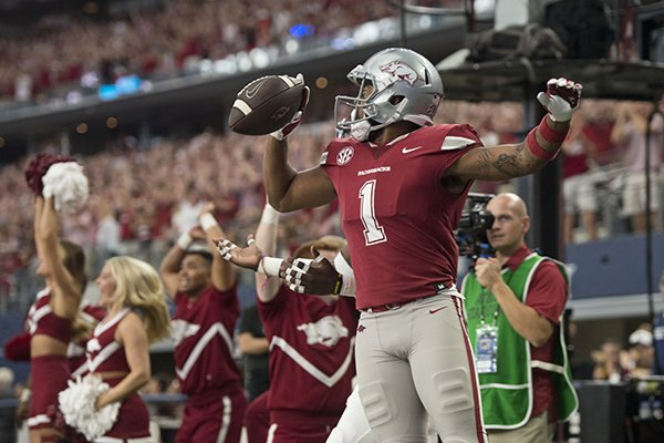 Arkansas receiver Jared Cornelius celebrates a touchdown score during a game against Texas A&M on Saturday, Sept. 23, 2017, in Arlington, Texas.
