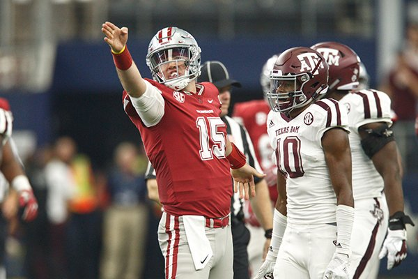 Arkansas quarterback Cole Kelley signals first down during a game against Texas A&M on Saturday, Sept. 23, 2017, in Arlington, Texas.