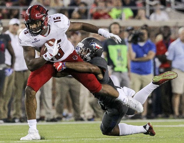 arkansas-states-blake-mack-is-tackled-by-smu-safety-rodney-clemons-during-the-first-half-of-saturday-nights-game-in-dallas-asu-led-14-10-after-one-quarter-but-smu-took-over-after-that