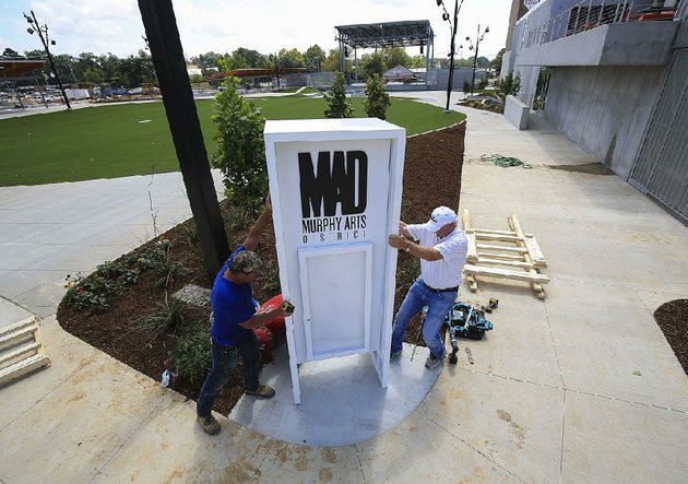 craig-garrett-left-and-bob-whitehouse-work-thursday-to-install-the-sign-for-the-new-amphitheater-in-the-murphy-arts-district-in-downtown-el-dorado