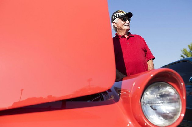 bill-price-of-elkins-takes-a-picture-next-to-a-1956-ford-thunderbird-on-saturday-during-the-bikes-blues-and-bbq-car-show-at-arvest-ballpark-in-springdale