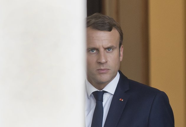 french-president-french-president-emmanuel-macron-walks-out-of-the-elysee-palace-as-he-awaits-european-parliament-president-antonio-tajani-in-paris-france-friday-sept-22-2017