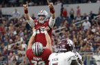 Arkansas offensive lineman Frank Ragnow lifts quarterback Cole Kelley, top, as the celebrate a touchdown against Texas A&M in the first half of an NCAA college football game, Saturday, Sept. 23, 2017, in Arlington, Texas. (AP Photo/Tony Gutierrez)