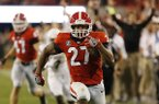 Georgia tailback Nick Chubb (27) runs on the way to a touchdown in the second half against Mississippi State during an NCAA college football game Saturday, Sept. 23, 2017, in Athens, Ga. (Joshua L. Jones/Athens Banner-Herald via AP)