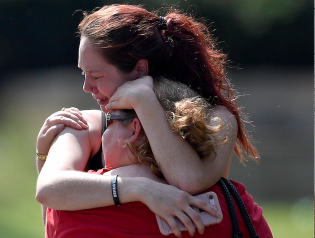 kaitlyn-adams-a-member-of-the-burnette-chapel-church-of-christ-hugs-another-church-member-at-the-scene-after-a-deadly-shooting-at-the-church-on-sunday-sept-24-2017-in-antioch-tenn-photo-courtesy-of-the-tennessean-via-the-associated-press