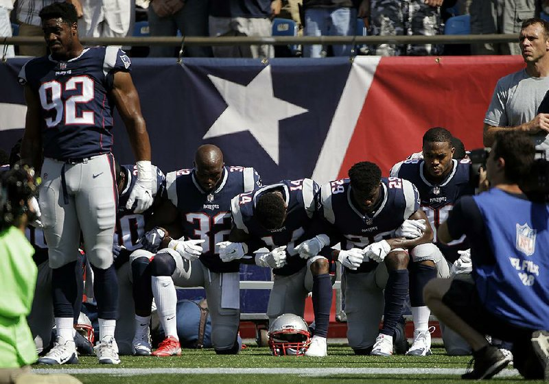 f6fd933855e New England Patriots players kneel during the national anthem before their  game Sunday with the Houston Texans in Foxborough