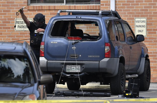 police-investigate-the-scene-outside-the-burnette-chapel-church-of-christ-after-a-deadly-shooting-at-the-church-sunday-in-antioch-tenn