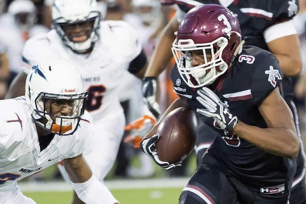 New Mexico State's Larry Rose III runs with the ball against UTEP during an NCAA college football game Saturday, Sept. 23, 2017, Las Cruces, N.M. (Robin Zielinski/The Las Cruces Sun-News via AP)