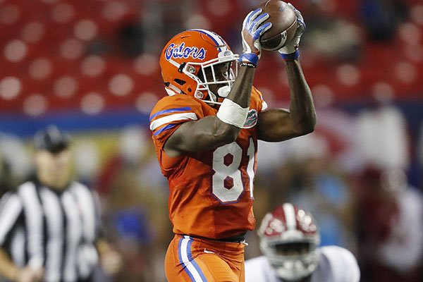 This Dec. 3, 2016, file photo shows Florida wide receiver Antonio Callaway (81) making the catch ahead of Alabama defensive back Ronnie Harrison during the first half of the Southeastern Conference championship NCAA college football game in Atlanta. (AP Photo/John Bazemore, File)