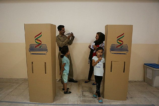 a-kurdish-man-in-irbil-iraq-takes-a-picture-as-his-wife-shows-her-ballot-during-voting-in-mondays-independence-referendum