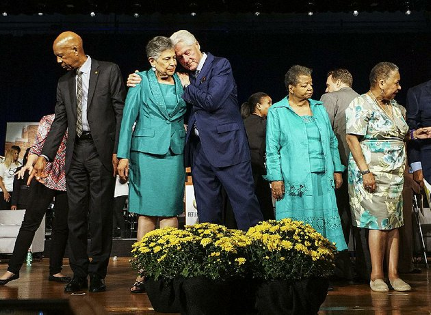 former-president-bill-clinton-embraces-carlotta-walls-lanier-one-of-the-little-rock-nine-at-the-end-of-the-commemoration-ceremony-monday-on-the-60th-anniversary-of-desegregation-at-little-rock-central-high-school-another-little-rock-nine-member-onstage-was-elizabeth-eckford-right