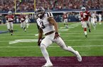 Texas A&M wide receiver Christian Kirk (3) celebrates in the end zone after returning a kick off 100 yards for a touchdown in the second half of an NCAA college football game against Arkansas on Saturday, Sept. 23, 2017, in Arlington, Texas. (AP Photo/Tony Gutierrez)