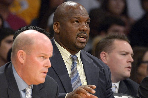 In this Nov. 9, 2012, file photo, Los Angeles Lakers assistant coach Chuck Person sits on the bench during the first half of an NBA basketball game against the Golden State Warriors in Los Angeles. (AP Photo/Mark J. Terrill, File)