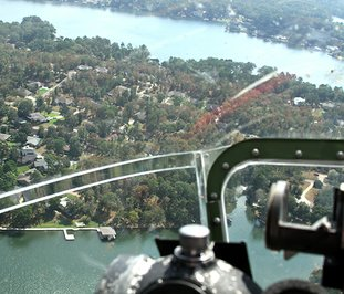 The Sentinel-Record/Grace Brown BIRD'S EYE VIEW: Lake Hamilton, left, as seen from the nose of the 1944 B-17 bomber Sentimental Journey as it flies over the city on Monday.