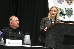 The Sentinel-Record/Richard Rasmussen MORNING ADDRESS: Arkansas Attorney General Leslie Rutledge, right, kicks off the annual meeting of the Arkansas Association of Chiefs of Police, which is celebrating its 50th anniversary, Tuesday morning as Hot Springs Police Chief Jason Stachey listens at the Hot Springs Convention Center. The convention is scheduled to run through Thursday.