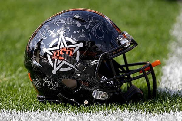An Oklahoma State football helmet is on the turf during warmups before an NCAA football game against Pittsburgh, Saturday, Sept. 16, 2017, in Pittsburgh. (AP Photo/Keith Srakocic)