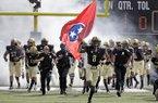 Vanderbilt cornerback Joejuan Williams (8) carries the Tennessee flag as the team takes the field before an NCAA college football game against Alabama Saturday, Sept. 23, 2017, in Nashville, Tenn. (AP Photo/Mark Humphrey)
