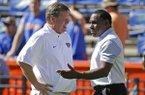 Florida head coach Jim McElwain, left, greets Vanderbilt head coach Derek Mason on the field before an NCAA college football game, Saturday, Nov. 7, 2015, in Gainesville, Fla. (AP Photo/John Raoux)