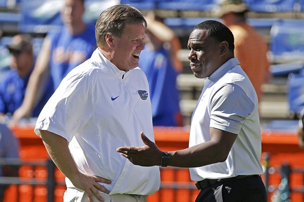 Florida head coach Jim McElwain, left, greets Vanderbilt head coach Derek Mason on the field before an NCAA college football game, Saturday, Nov. 7, 2015, in Gainesville, Fla. (AP Photo/John Raoux)