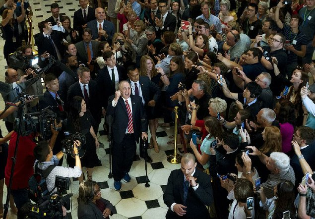 Applause, laughter as wounded lawmaker Scalise returns to Congress