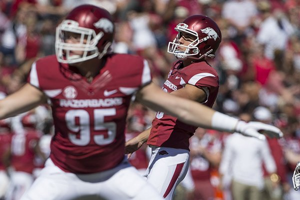 Arkansas kicker Connor Limpert watches an extra-point attempt go through the uprights during a game against New Mexico State on Saturday, Sept. 30, 2017, in Fayetteville.