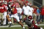 Arkansas receiver Deon Stewart runs past New Mexico State defender Terrill Hanks on a touchdown reception in the first quarter of a game Saturday, Sept. 30, 2017, in Fayetteville.